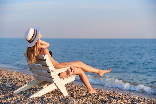 Young woman sunbathing on a beach